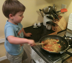 Boy cooking on Stove