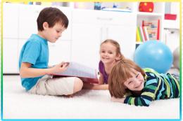 Boy reading to girls